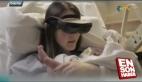 Görme engelli anne bebeğini özel gözlükle gördü